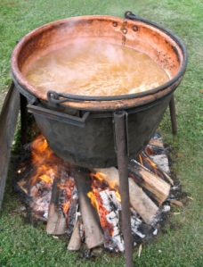 Apple butter boiling in an open kettle