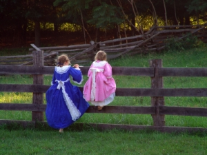 young girls in colonial garb at historic farm