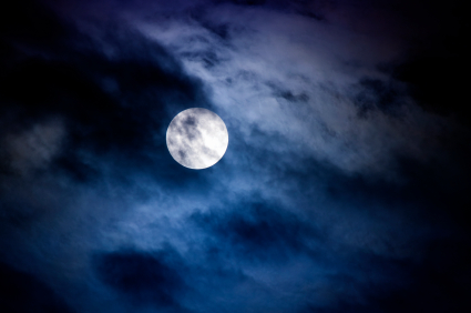 full moon and clouds--blue-black night sky, haunting