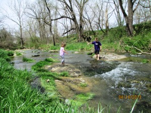 children playing in creek