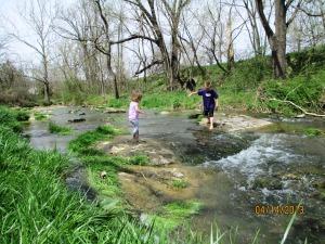 children playing in creek