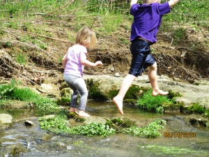 Children at play in creek