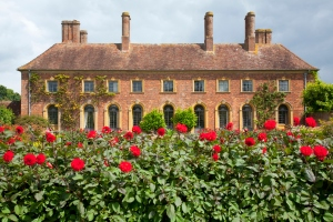 Old English Manor with red roses