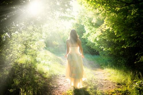 Fairy woman walking in the woods