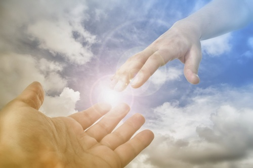 God's hand reaching out to man