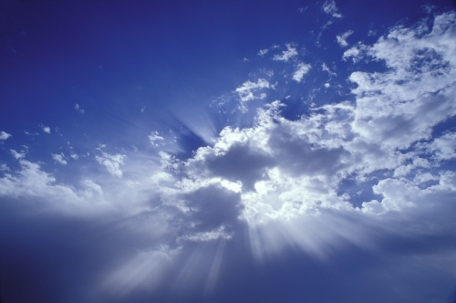 Heavenly light in white clouds and blue sky