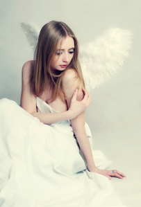 Young woman angel with wings