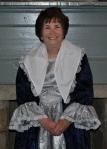 In Martha Washington gown