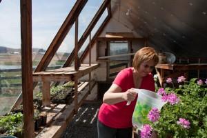 Beth in solar greenhouse