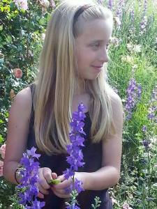 Emma in the garden with larkspur1