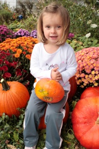 chloe-sitting-on-our-pumpkins
